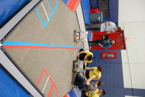 "The W.A.L.K.E.R.S., left, take on the competition at the ""Garden State Rumble"" robotics competition."