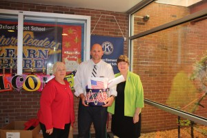 Chapter members Sue Beall and Jan Hunold present Constitution-themed baskets to Oxford Street School Principal Christopher Karabinus.