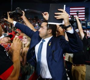 A volunteer member of the advance team for #president #donaldtrump blocks the lens of a photographer trying to take a photo of a