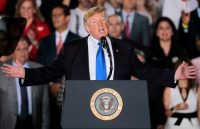 The chairman of the far-right Proud Boys sat behind Trump at his latest speech