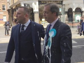 Nigel Farage 'trapped on bus' surrounded by protesters holding milkshakes