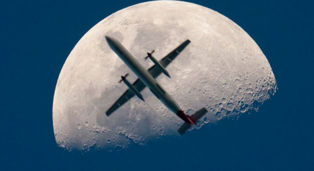 airplane-passing-the-mooon-perfect-timing.jpg
