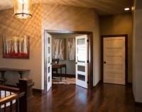 Dark Poplar Baseboard Trim with White Doors - Iowa Remodels