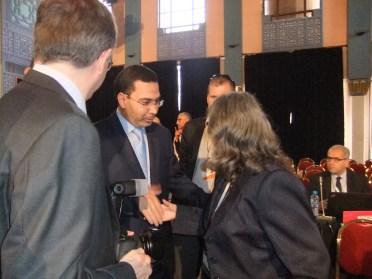 Khalfi congratulating Brunson. (Photo Credit: Catherine Saez, IP-Watch)