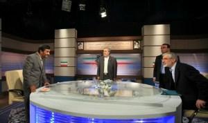 Iran's President Mahmoud Ahmadinejad(left), talks with Mir Hossein Mousavi ( right), before their TV debate on June 3, 2009. (Photo Credit: IRIB)