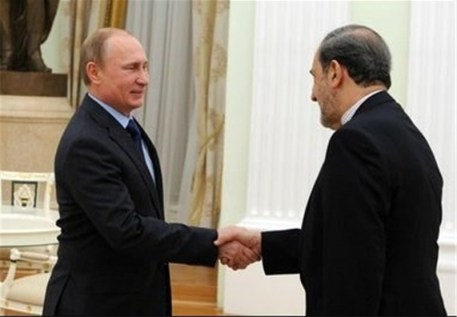 ran's Ali Akbar Velayati (R) shakes hands with Russian President Vladimir Putin before a meeting in Moscow on January 28, 2015. (Photo Credit: TasnimNews.)