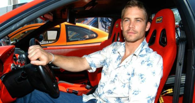 US actor Paul Walker poses in a car for photographers to promote 2 Fast 2 Furious in 2003. Walker died in a car crash in California yesterday. Photograph: Emilio Naranjo/EPA