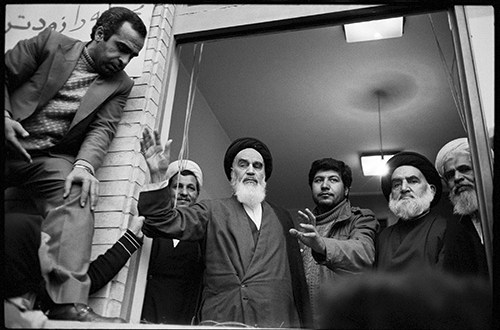 "IMAGE IS FOR YOUR ONE-TIME EXCLUSIVE USE ONLY FOR MEDIA PROMOTION OF THE NATIONAL GEOGRAPHIC BOOK ""44 DAYS: IRAN AND THE REMAKING OF THE WORLD."" NO SALES, NO TRANSFERS.  ©2009 David Burnett  Ayatollah Khomeini greets supporters at the Refah School. To his right is his aide Akbar Hashemi Rafsanjani. Tehran 