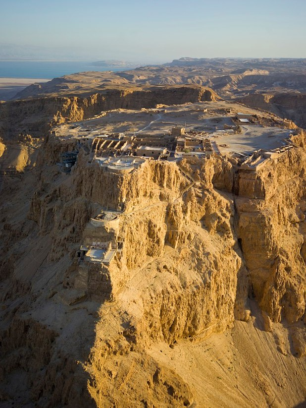 Aerial view of Masada מצדה), in the Judaean Desert ( מִדְבַּר יְהוּדָה‎, صحراء يهودا), with the Dead Sea in the distance. Photo: Andrew Shiva
