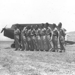 Hagana members undergoing the first flying training course organized by Aviron Company in the Jordan Valley near Kibbutz Afikim, with their Chief Imanuel Tzur