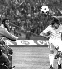 Yugoslav forward Dusan Bajevic (R) heads the ball