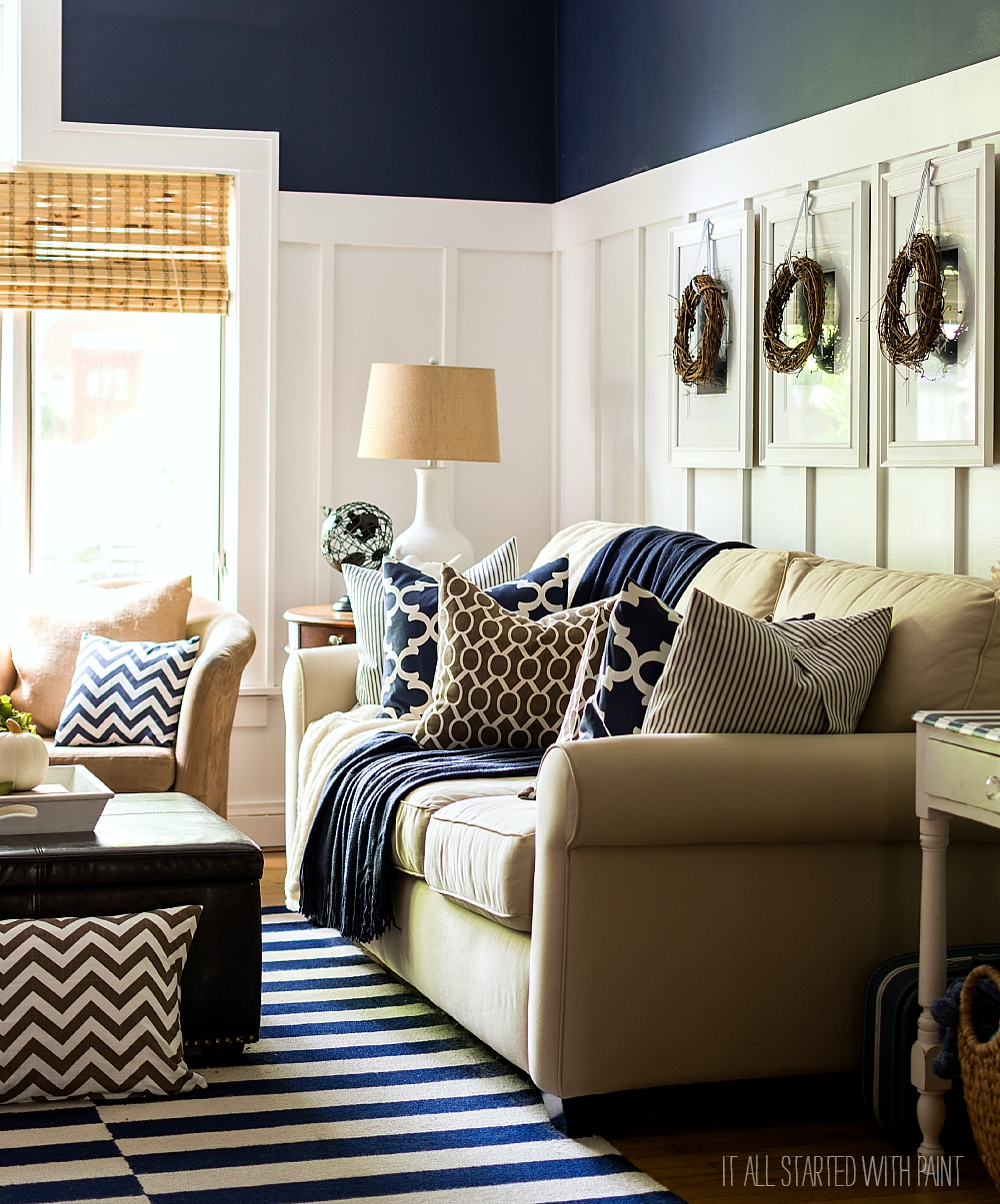 Fall decorating ideas using brown and navy neutrals board and batten living room decorated for