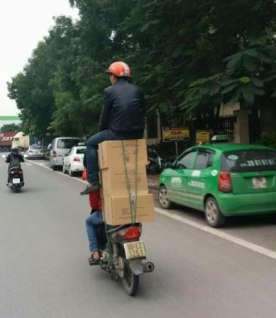 Dangerous motorbike stacking in Vietnam