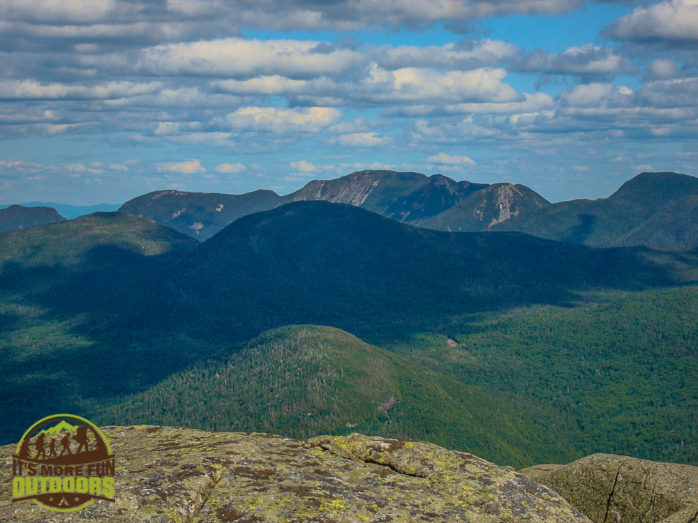 Looking out at the Great Range. A Summer summit of Wright Peak in the Adirondack Mountains of NY. August 7, 2010