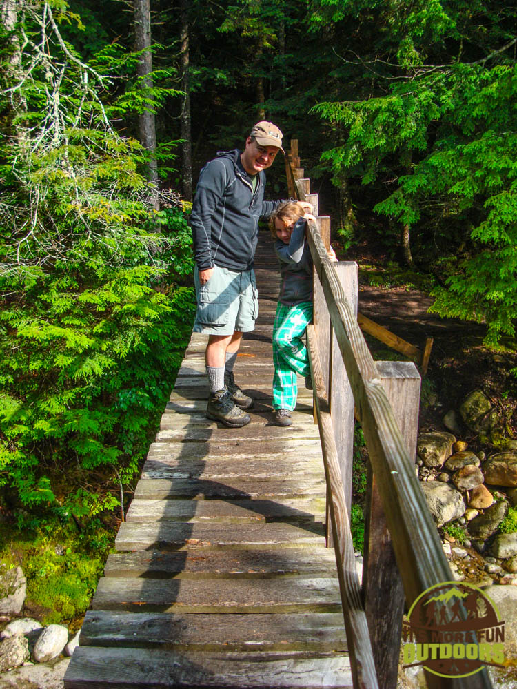 Trail Tip Tuesday: The First Family Backpacking Trip Tip #10: Go some place with a variety of interesting things to do and see. A bridge over the brook that leads to John's Brook Lodge, and several lean to's.