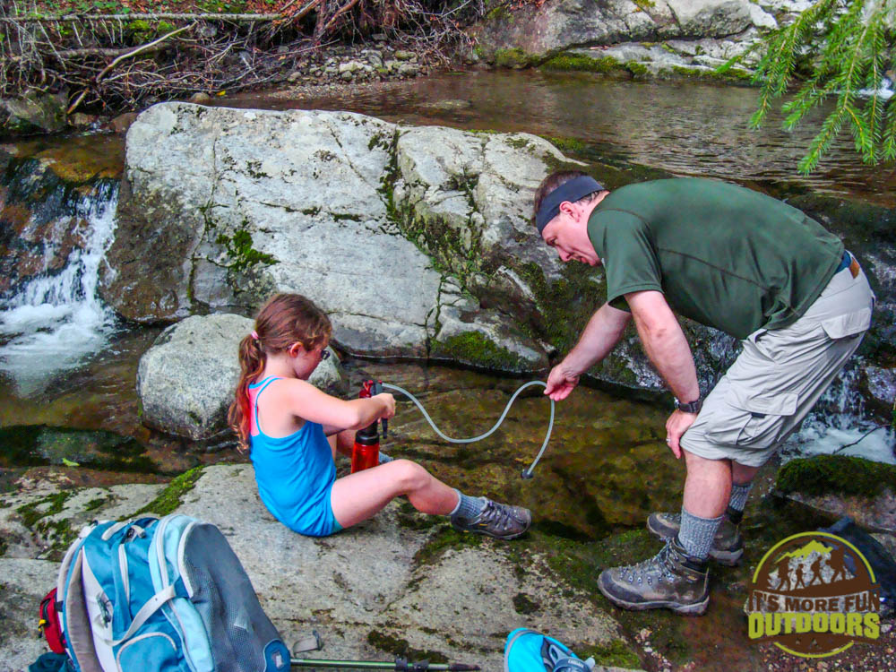 Trail Tip Tuesday: The First Family Backpacking Trip Tip #9: Involve the kids in the camp chores, what is mundane to you may be fun for them! Dora absolutely loved learning how to operate the water filter!