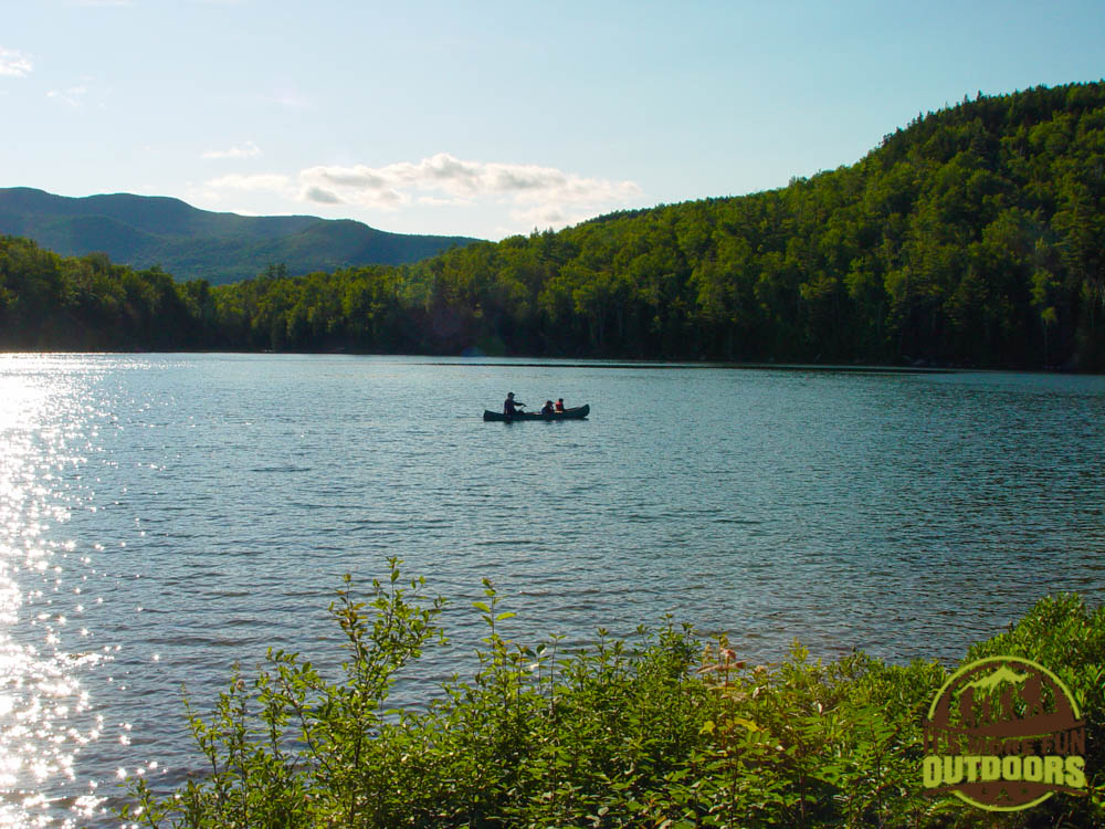 A family paddling a rental canoe on Heart Lake. The Adirondak Loj rents canoes, kayaks and SUPS!