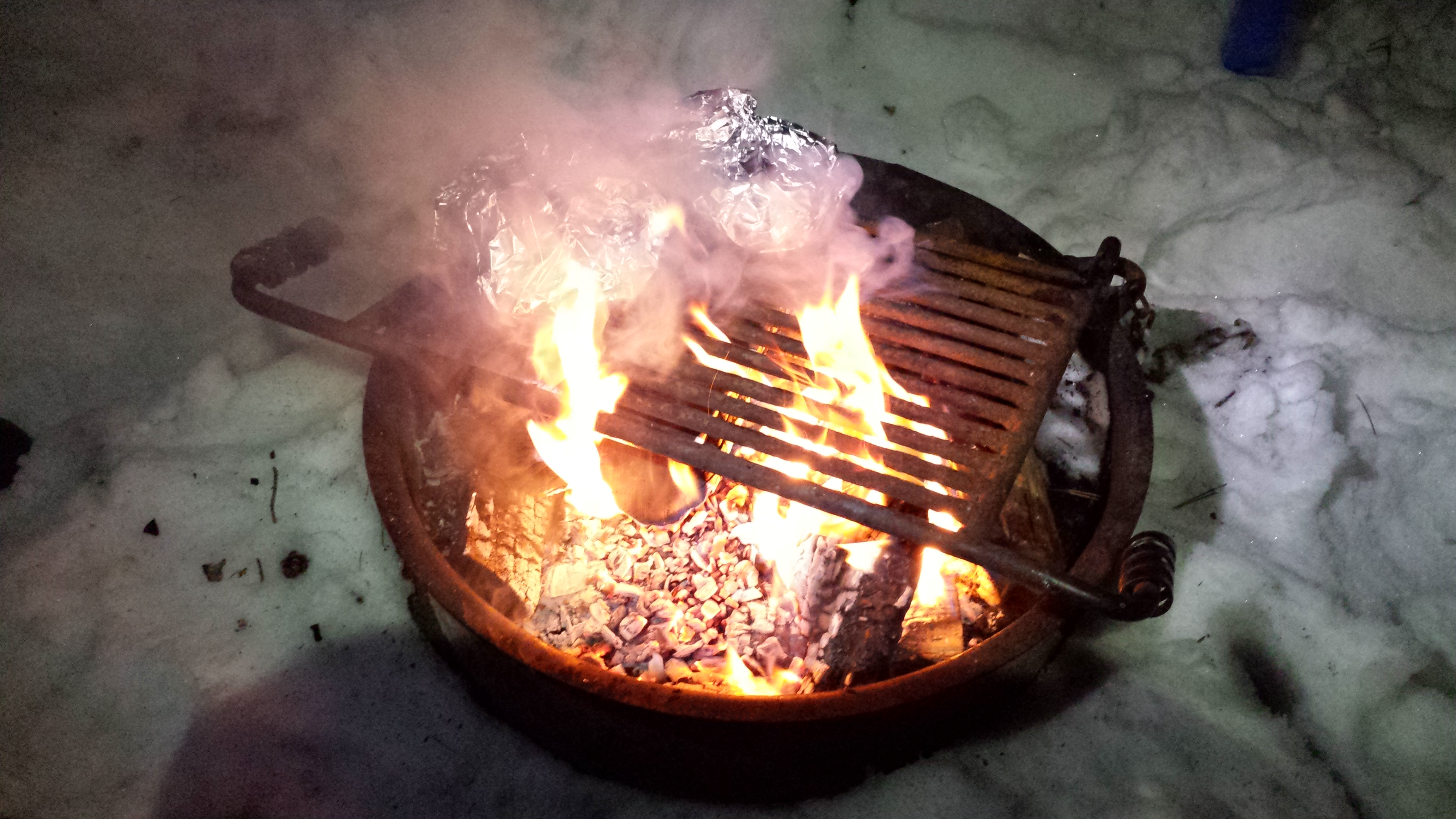 Mmmmm...campfire dinner while lean to camping in the Winter at ADK's Wilderness Campground at Heart Lake.