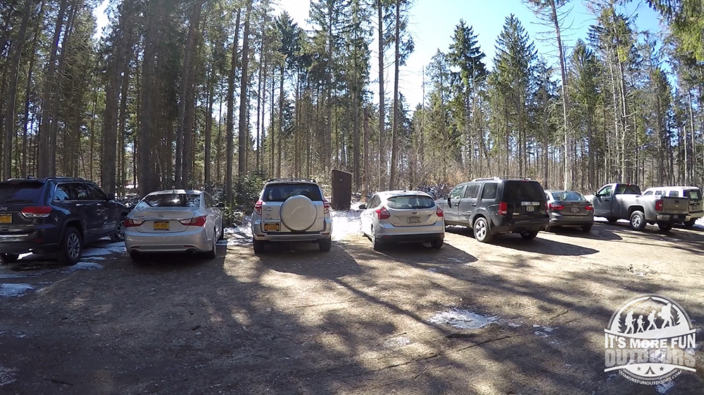 Parking lot at the Azure Mountain trailhead - 11 cars there when we arrived. Note the Privy!ac 3/19/2016: Winter hike-Azure Mountain Fire Tower, Debar Mountain Wild Forest, Adirondacks