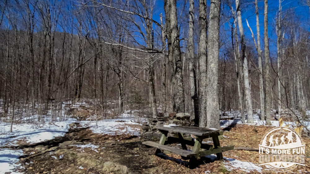 Picnic table and chimney remains along the Azure Mountain trail. 3/19/2016: Winter hike-Azure Mountain Fire Tower, Debar Mountain Wild Forest, Adirondacks