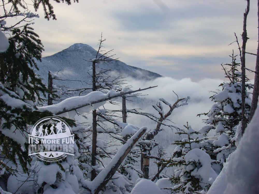 I believe this is Mt. Marcy in the distance. Super cool undercast as we get our first glimpses of the surrounding high peaks! 12/26/2010: Winter Climb of Phelps Mountain in the Adirondacks!