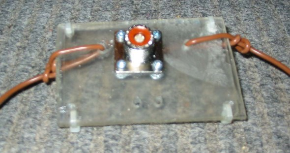 Photo 1 – Socket bolted to the perspex, and wires tied off.