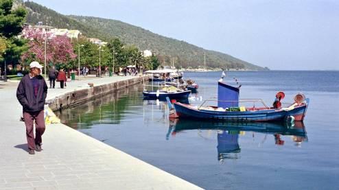 People walking at the port of Amfilochia.