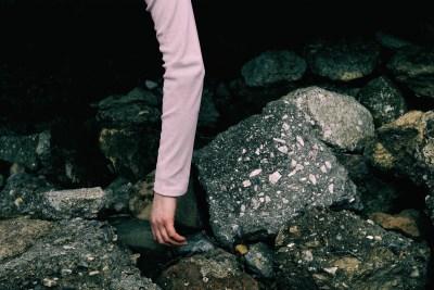 A Lifeless Hand amidst the Rocks