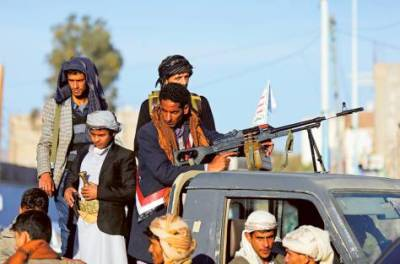 Al Houthi rebels secure the venue of Eid Al Adha prayers in Sana'a yesterday. There are longstanding connections between Iran and Al Houthis, who have sent members to Tehran for training and borrowed widely from Iranian revolutionary ideology.