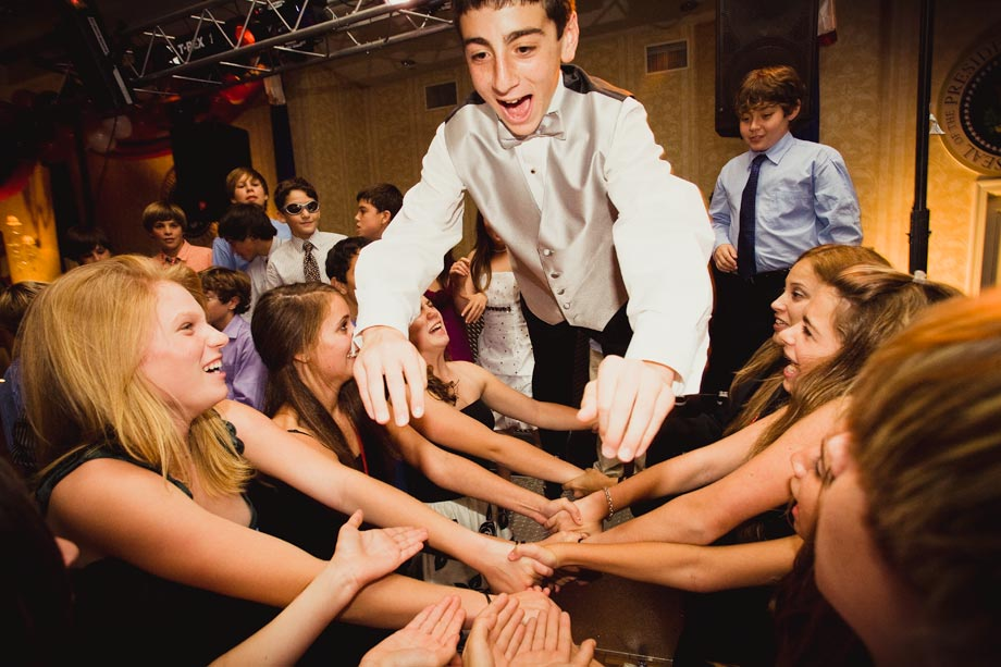 mitzvah boy diving into arms of friends