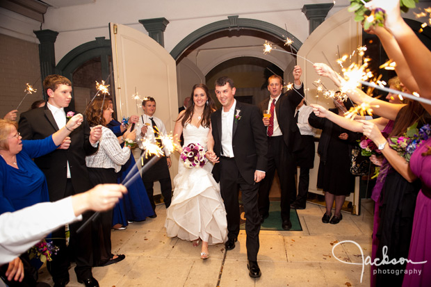 bride and groom leaving reception with sparklers