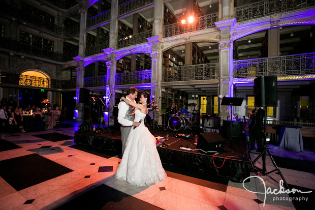 bride and groom on dancefloor lit by purple lights