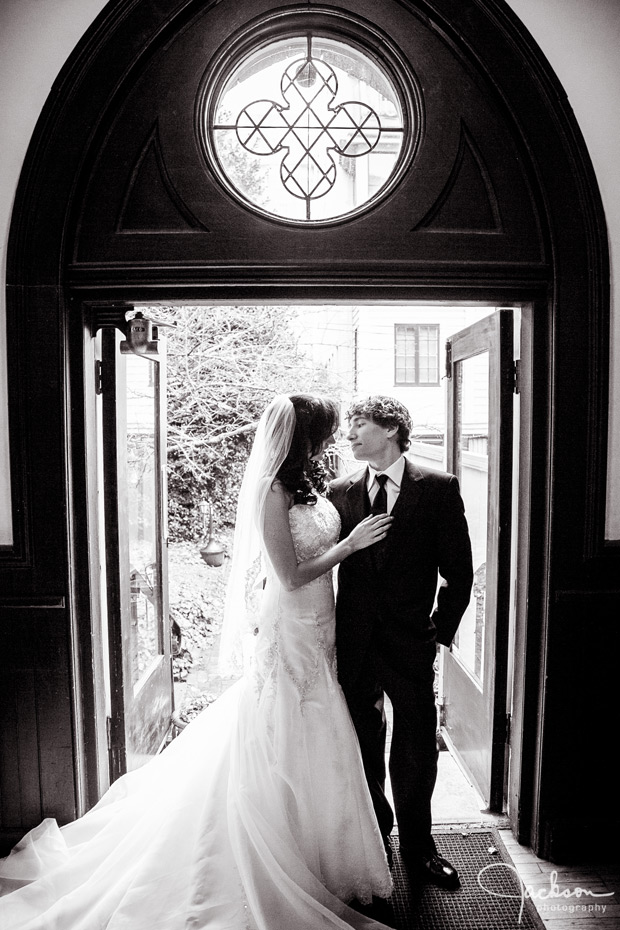bride and groom in gothic doorway