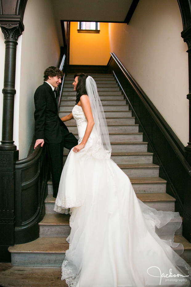 bride and groom in tall stairway