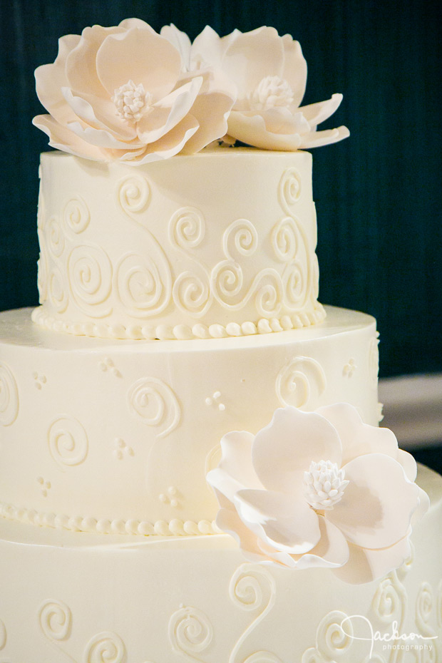 detail of ornate iced flowers on cake