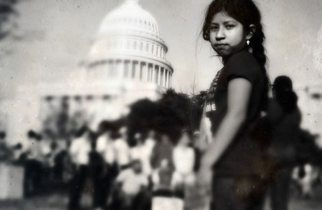 "Meshelle Fernandez, 7, of Chester, Va., whose parents are from Mexico, participates in the ""Rally for Citizenship,"" a rally in support of immigration reform, on Capitol Hill in Washington, on Wednesday, April 10, 2013. Her father, Luis Fernandez, says that it's important to be at the rally and support families."