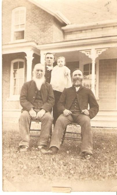 Back: Jesse Lewis Climenhage holding Claude Aquilla Climenhage. Front: David Climenhaga and his son Daniel Climenhage. Note the name change (circa 1906).
