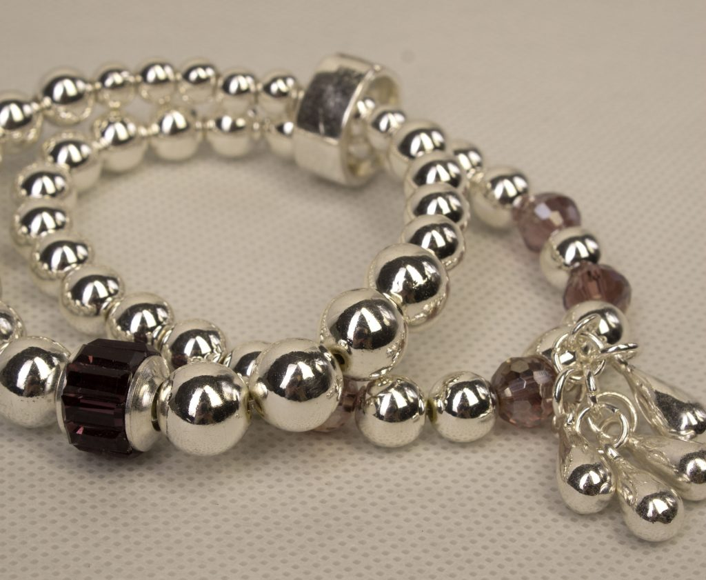Silver Stretch Bracelet With A Purple Crystal Bead And