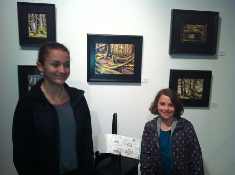The Kendrick Ladies with their beautiful smiles, in front of some of the works in Haida Gwaii