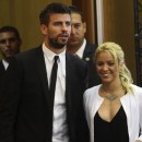 Colombian pop star and United Nations Children's Fund ambassador, Shakira, walks with her boyfriend Gerard Pique, after her joint news conference with Israel's president Peres at 3rd annual Israeli Presidential Conference in Jerusalem