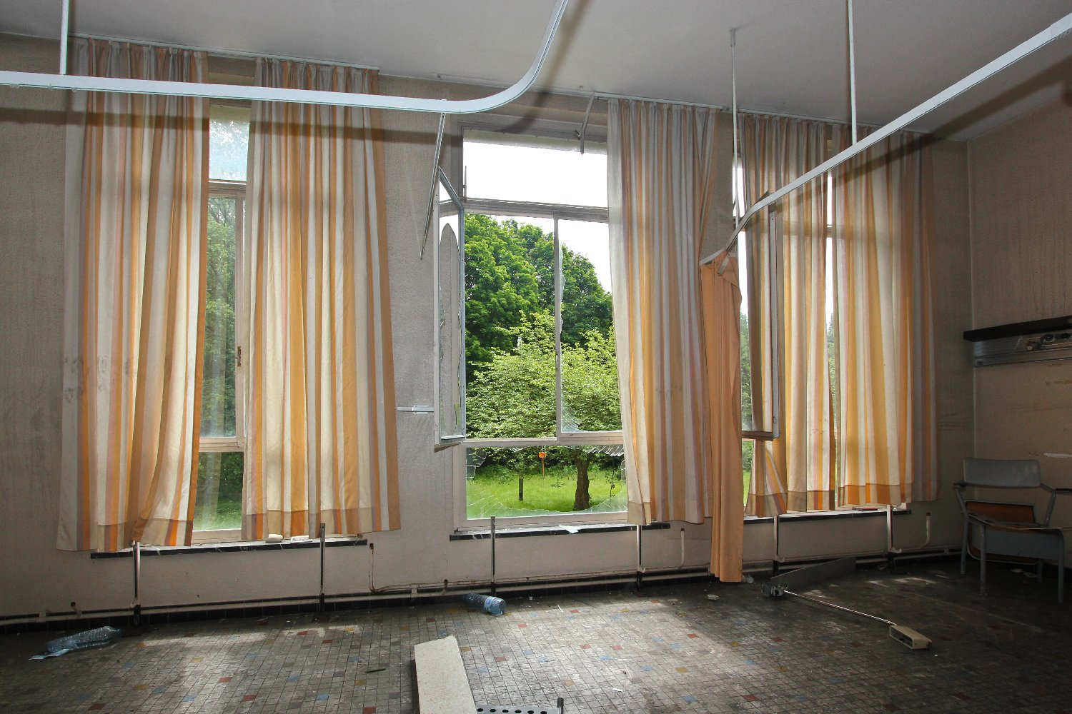Some rooms still have their curtains in place