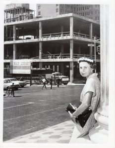 Virginia King in front of the Carnegie Library as the Hayden Burns Library is under construction.