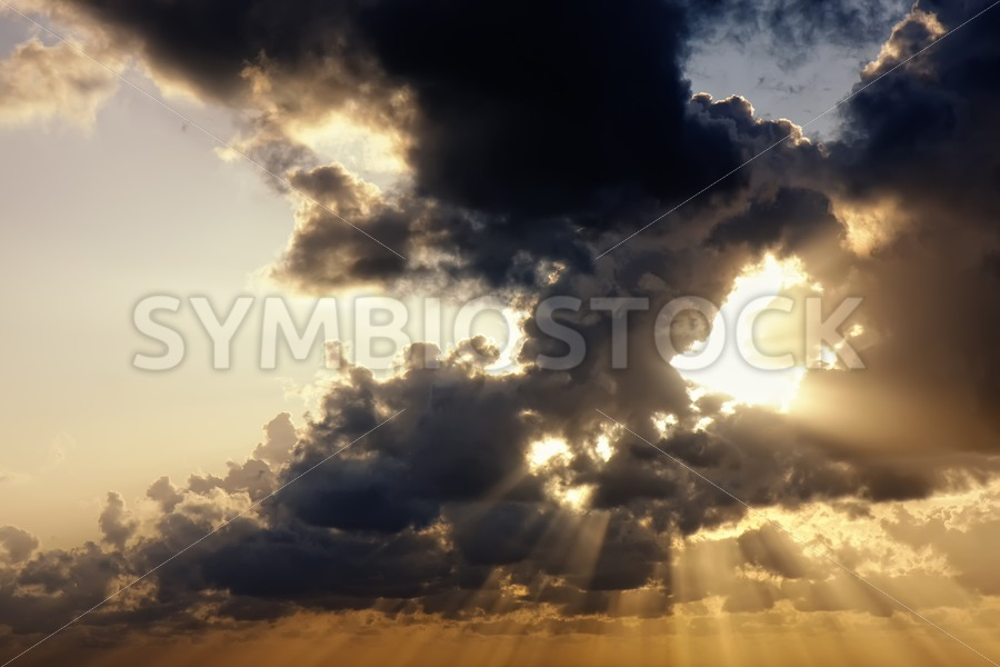 Sunrays through clouds - Jan Brons Stock Images