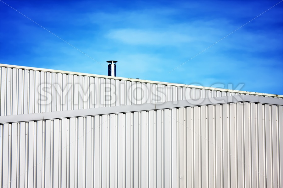 Air Pipe on steel building - Jan Brons Stock Images