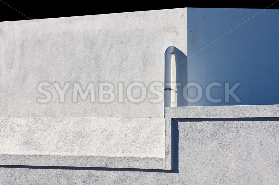 Concrete wall sun shadow - Jan Brons Stock Images