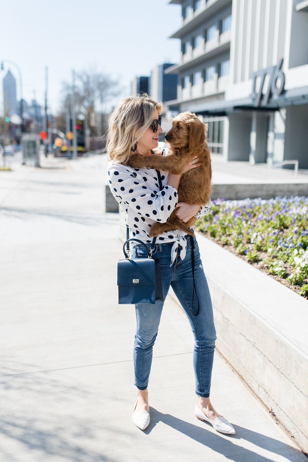 button up jeans and a tie front polka dot blouse