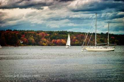 New Hampshire coast during the fall foliage season. Sailboats catching the last sailing days