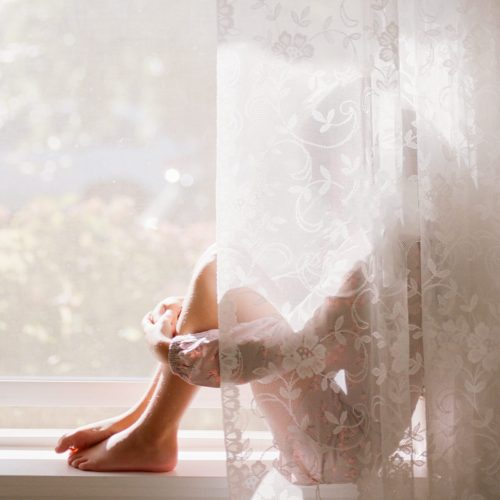 Girl behind curtain