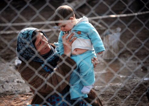 Syrian mother and child in Iraqi refugee camp