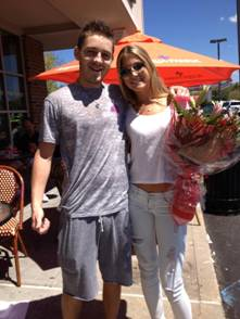 Alex Genatt and Carly Sandler stand in front of the restaurant of the promposal. Photo Source: Facebook